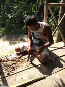 Jorge making utensils from coconut trees