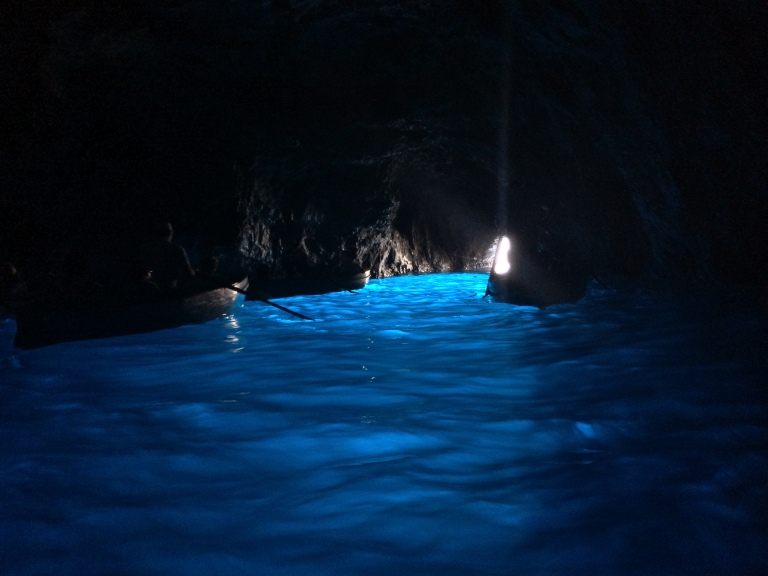 Blue Grotto (Grotto Azzurro) is a sea cave on the coast of the island of Capri. Sunlight, passing through an underwater cavity and shining through the seawater, creates a blue reflection that illuminates the cavern. The cave extends some 50 meters into the cliff at the surface, and is about 150 meters deep, with a sandy bottom.