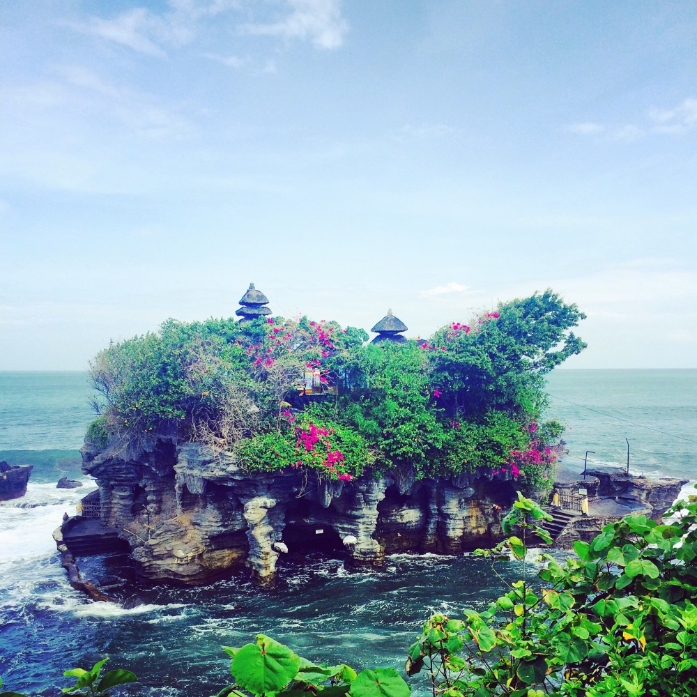 Tanah Lot Temple which was built on a natural source. It can only be visited during low tide. (remember from Tan a lot)  :)