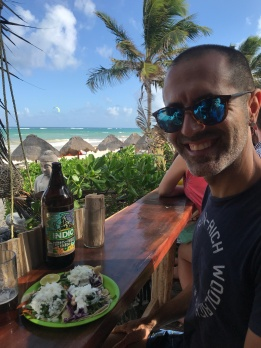 Michi enjoying cold beer and tacos on the beach